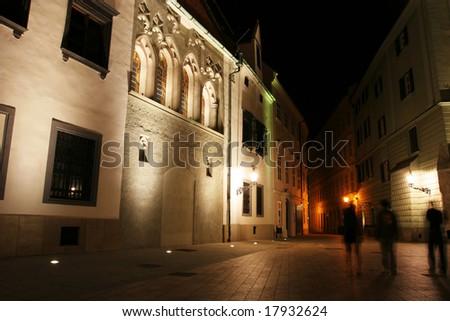Old city street at night (Bratislava, Slovakia) - stock photo