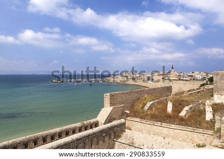 Old city walls and harbor of acre in north israel - stock photo