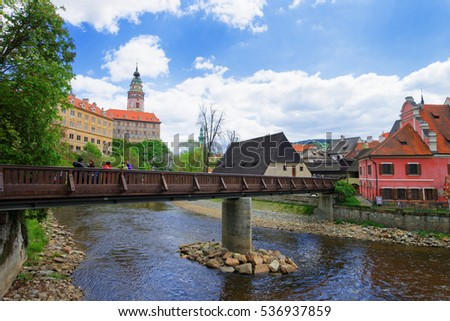 Old city with State Castle and the bend of Vltava River, Cesky Krumlov in Czech Republic. People on the background