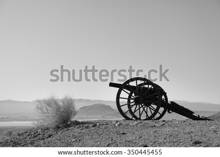 Old Civil War Cannon in the field of lookout mountain in Calico Ghost Town. Black and White photography