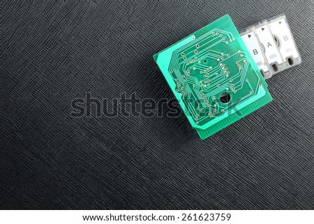 Old classic and vintage style of mini cassette and circuit board represent the sound recording technology.  - stock photo