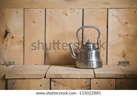 Old classic and vintage teapot on wooden texture