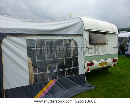 Old classic caravan on a campsite for a holiday vacation