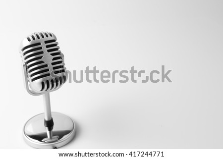 Old classic microphone on plain background