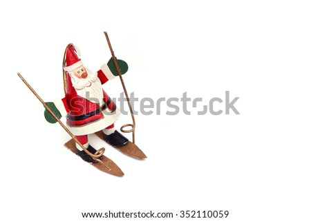 old classic Santa Claus tin toy playing ski isolated - stock photo