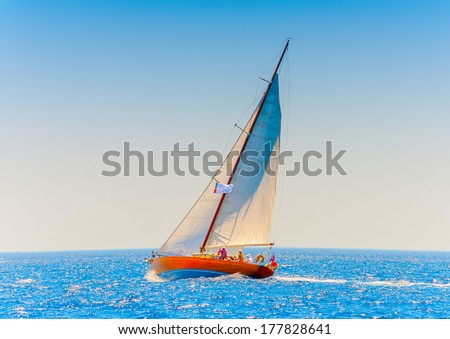 Old classic wooden racing sailing boat, during a Classic Boats Regatta in Spetses island in Greece - stock photo
