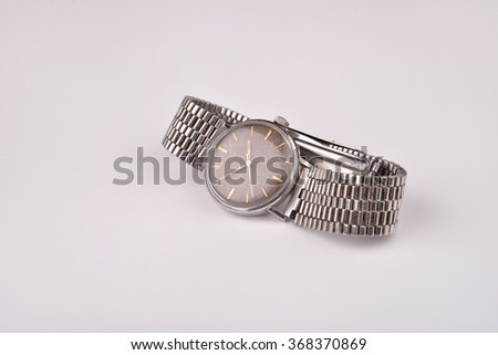 Old classic wrist watch for man with metal strap - stock photo