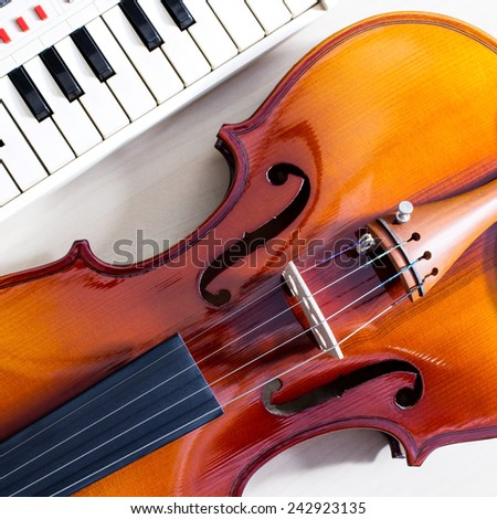 old classical violin & music keyboard , piano - stock photo