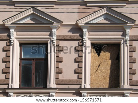 Old classicism style windows under reconstruction in old town of Vilnius, Lithuania - stock photo