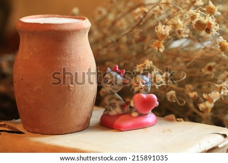 old clay jug of milk dry food health daisy flowers book statuette cat kitten heart love romance Breakfast - stock photo