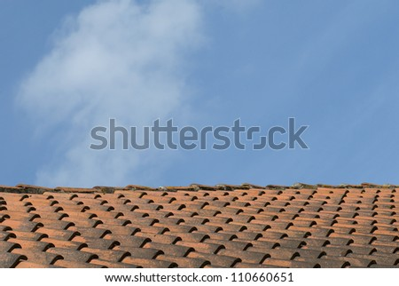 Old clay roof tiles with blue sky, Ribe, Denmark.
