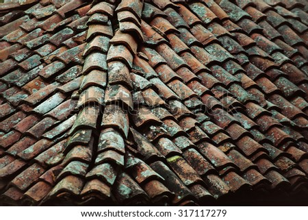 old clay tile roof, popular option roof - stock photo
