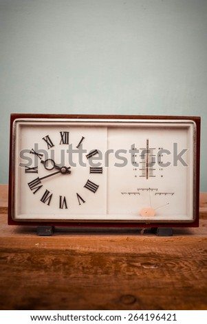 Old clock and barometer - stock photo