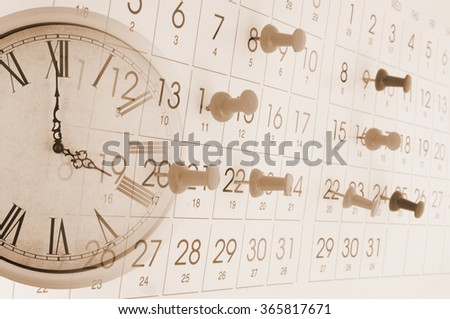 Old clock and calendar with push pins, time concept - stock photo