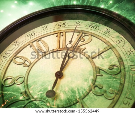 Old clock at 12 and fireworks - stock photo