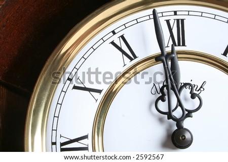 Old clock close-up with roman numbers - stock photo