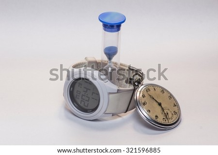 Old Clock, Hourglass and modern watch isolated on white - stock photo