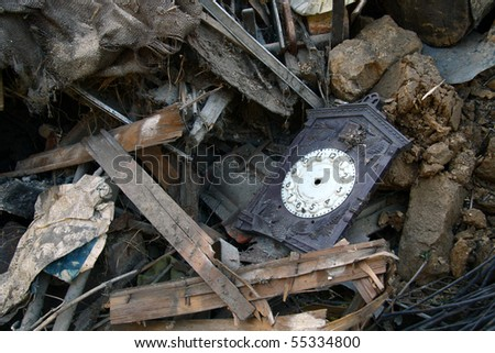 Old clock in the rubbish - stock photo