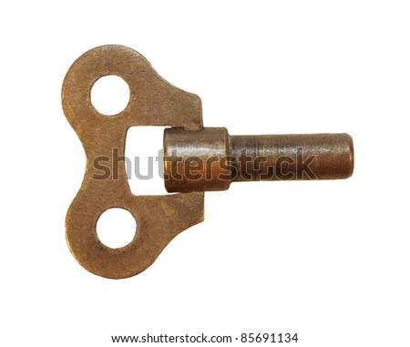 old clock key winder isolated on white background, texture - stock photo