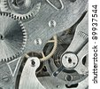 Old clock mechanic inside, clockwork close up. - stock photo