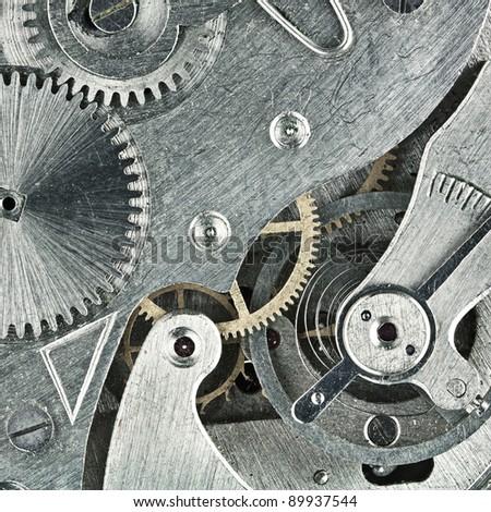 Old clock mechanic inside, clockwork close up. - stock photo