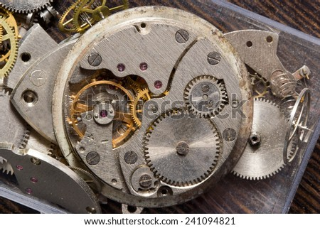Old clock mechanism in macro scale - stock photo