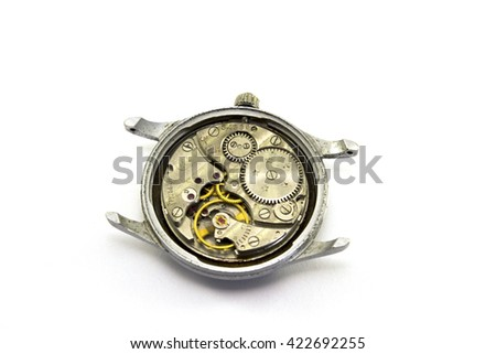 Old clock mechanism on white background - stock photo