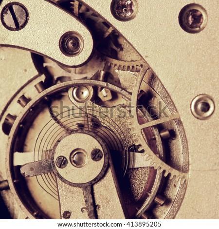 Old clock mechanism with cogwheels macro - stock photo