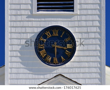 old clock on a church steeple - stock photo