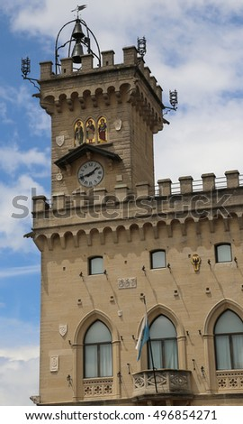 old clock tower with mosaics in the Palace of the Government called Palazzo Pubblico of San Marino in Central Italy