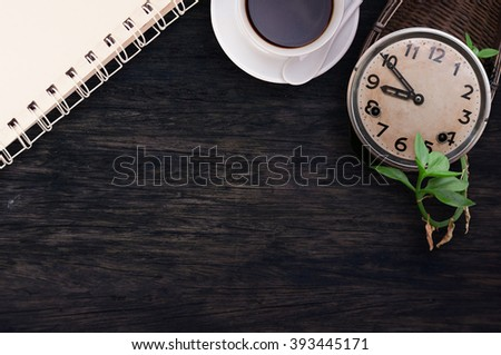 old clock vintage picture , blank note paper, coffee on wood desk top view. empty space for text. selective focus. - stock photo