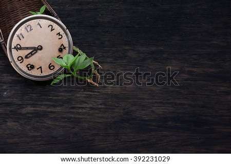 old clock vintage picture in wood background. View with copy space. selective focus. - stock photo