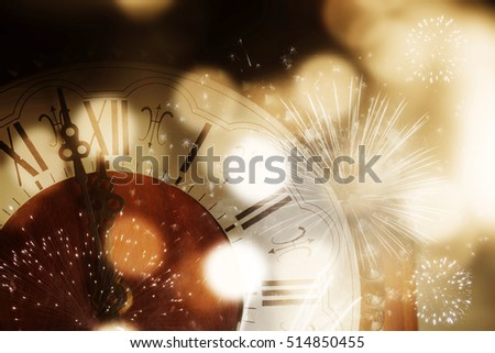 old clock with fireworks and holiday lights - New Year's at midnight