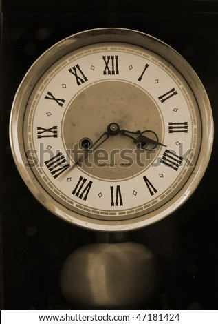 Old clock with roman numerals - stock photo