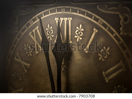 Old clock with roman numerals. Selective focus on  number XII and minute hand. Intentional vignetting. - stock photo