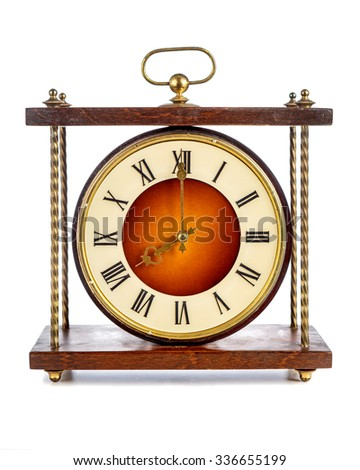 Old clock with roman numerals showing eight o'clock over white background - stock photo