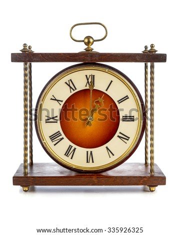 Old clock with roman numerals showing one o'clock over white background - stock photo