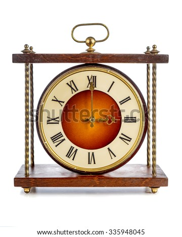 Old clock with roman numerals showing three o'clock over white background - stock photo