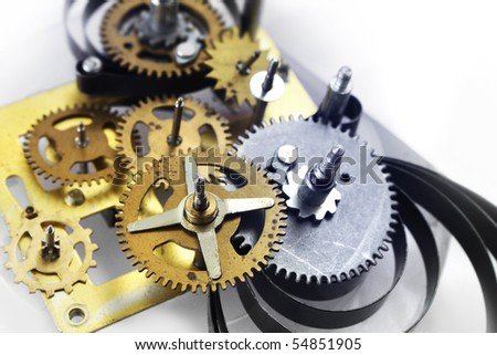 Old clockwork mechanism with brass metal gears and cogs - stock photo
