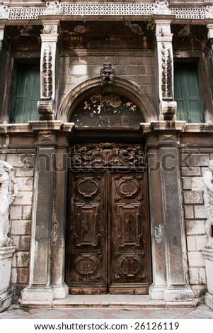 Old closed door (Venecia, Italy) - stock photo
