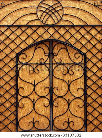 Old Closed gate with  Asian pattern - stock photo