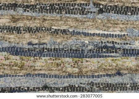 Old cloth carpet texture of. dirty rag, horizontal and vertical stripes, mixed colors - stock photo