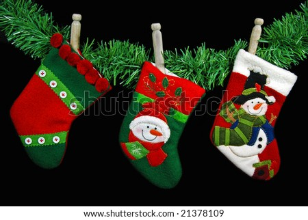 old clothespins holding stockings - stock photo
