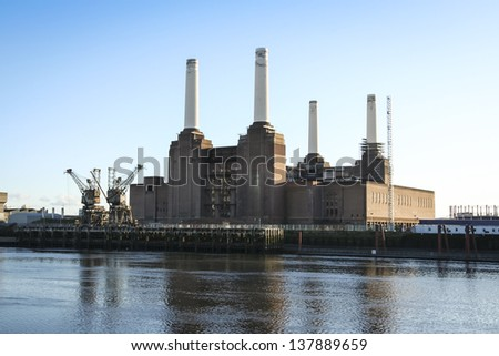 old coal fired victorian power station in battersea london on the bank of the thames