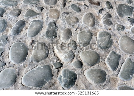 Old cobble stone road background texture
