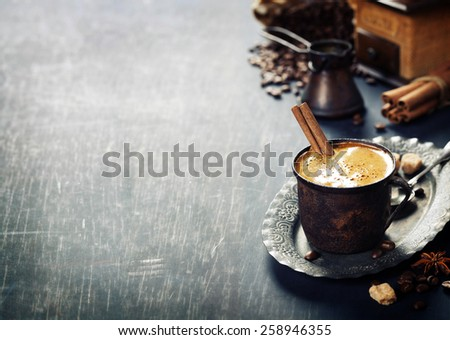 Old coffee cup and mill on dark rustic  background - stock photo