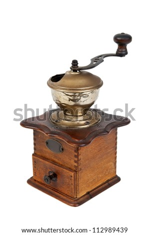 old coffee grinder against white background