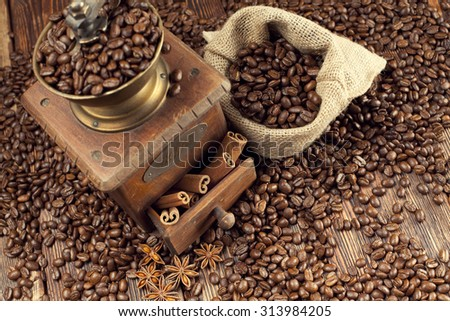 Old coffee grinder and coffee beans  - stock photo