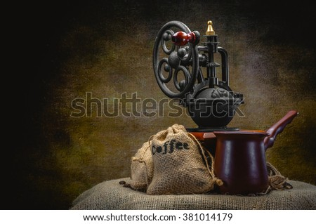 old coffee grinder and coffee on dark background