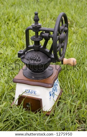 Old coffee grinder on grass #1 - stock photo